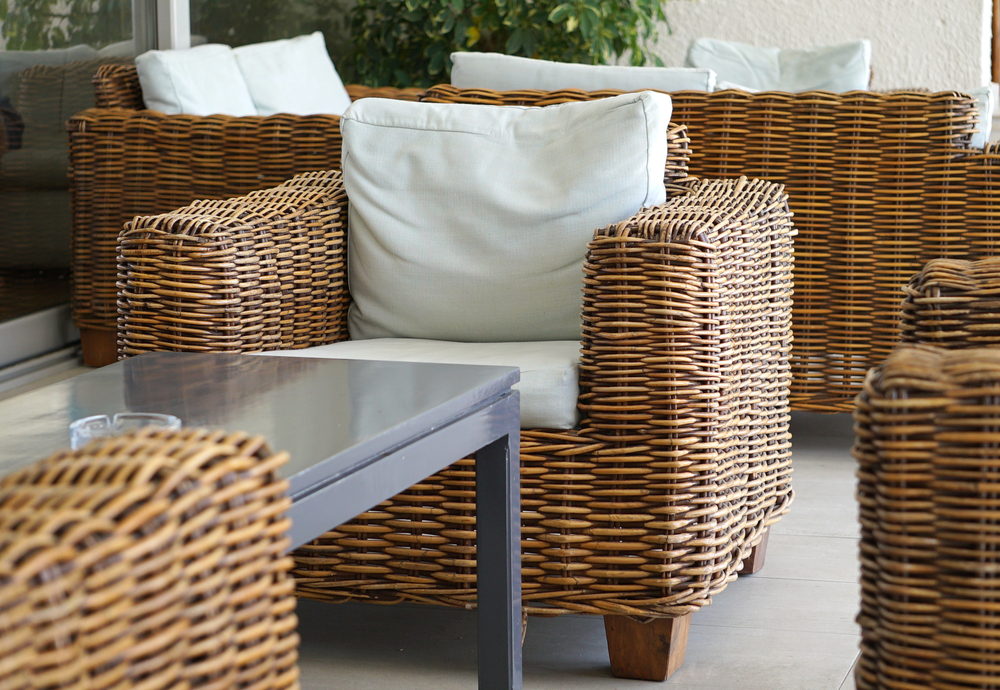 Wicker chairs on a back patio in a desert landscape